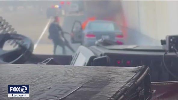 San Jose police officer pulls man from burning car
