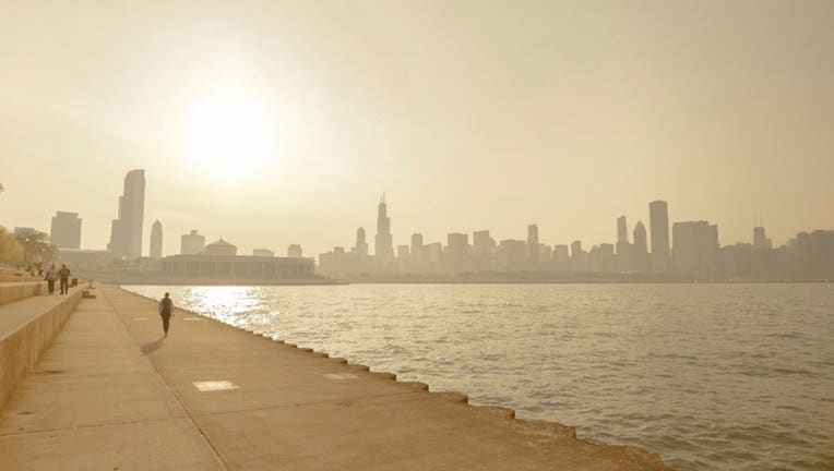 This FILE photo shows smog on the shoreline of Chicago during a summer heat wave.