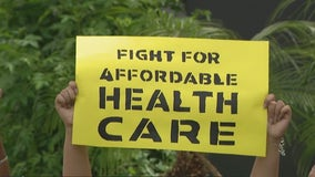 Groups rally outside Arizona Sen. Sinema's office to address child care, climate change, education