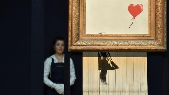 Bansky street art that self shredded at auction sells for $25.4 million