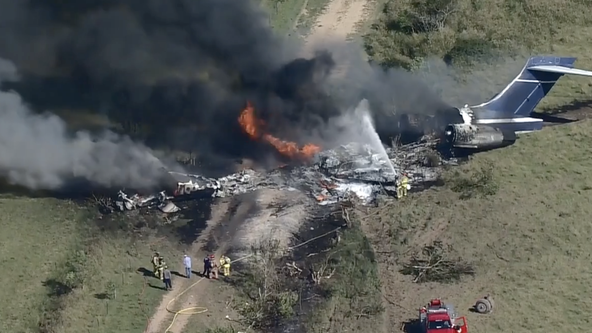 Plane carrying multiple people engulfed in flames after crashing in Waller County