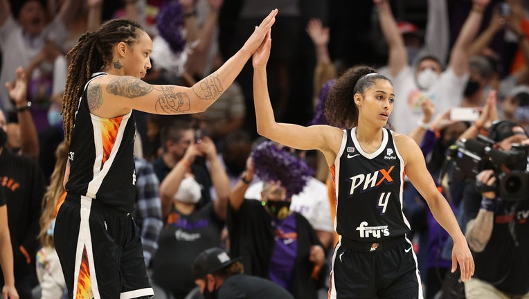 Brittney Griner #42 and Skylar Diggins-Smith #4 of the Phoenix Mercury celebrate after defeating the Chicago Sky in Game Two of the 2021 WNBA Finals at Footprint Center.