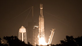 Night light: SpaceX launches hefty rocket with 24 satellites