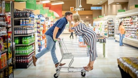 Couple takes adorable engagement photos in Publix store where they met