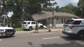 Vehicle hits house in Seminole Heights