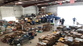 Ready for delivery: Venice hangar stuffed with supplies for the Bahamas