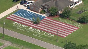 Giant flag painted on home's lawn in Plant City