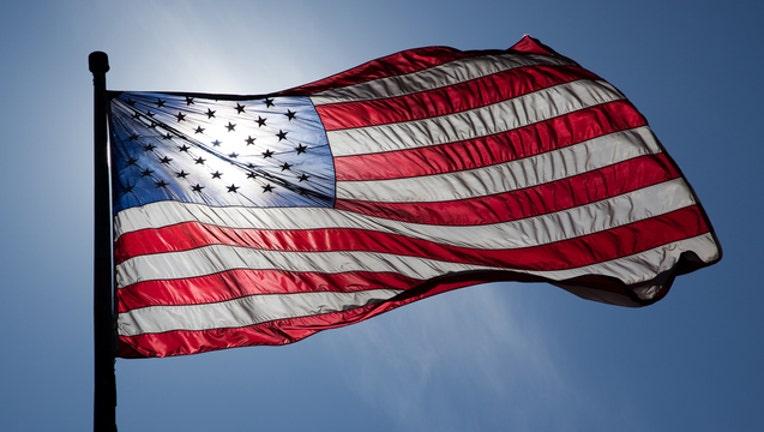 9ec82502-American flag_1447175688599.jpg