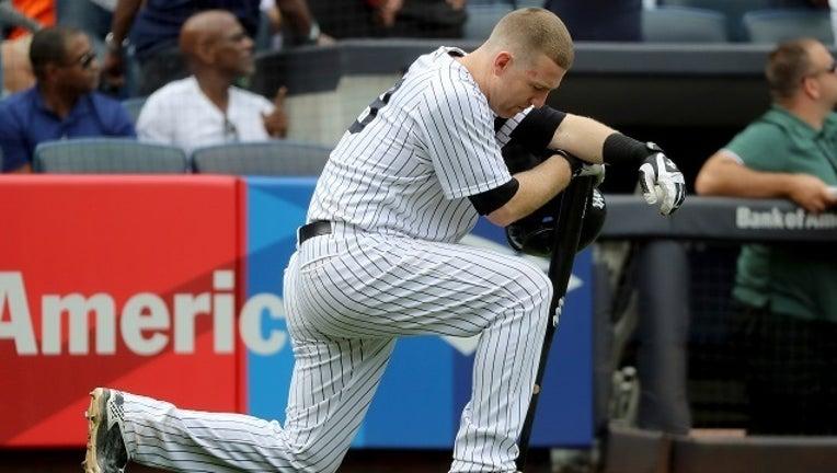 6371de8c-GETTY Todd Frazier Yankees Kneel-401096
