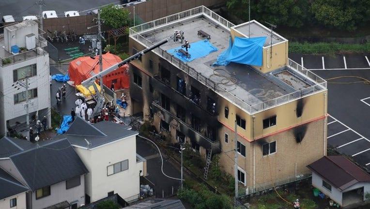 cf0fd85c-GETTY Kyoto anime studio fire 1156206162_1563456083378-408795