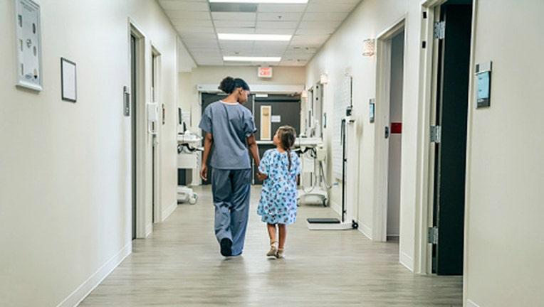 9e3bb91f-Getty_kid in hospital_122618_1545830654027.jpg-403440.jpg