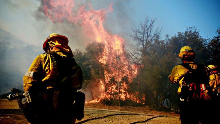 eca69600-Firefighterslookon_111418_GETTY-407068