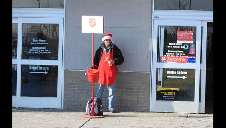 d547c0f3-Salvation_Army_red_kettle_at_supermarket_entrance_Ypsilanti_Michigan_1448925953597.JPG