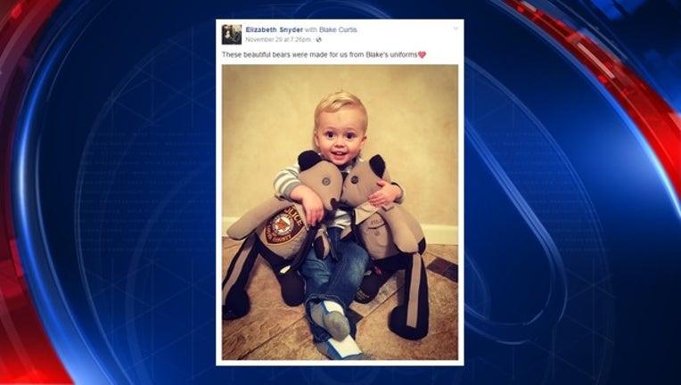 e25deefd-Son of slain officer receives toy bears_1480879502646-401720.jpg