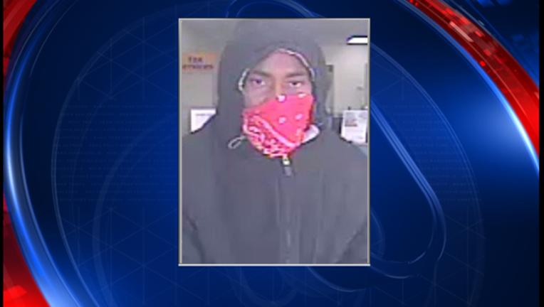 2fdb5cce-armed robber mug web_1483222425188.PNG