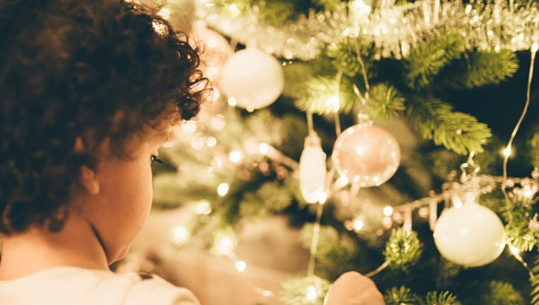 d3cfa1de-generic christmas kid_1511862989733.jpg