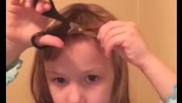 22c1ce52-girl cuts hair_1453947214657-404959.jpg