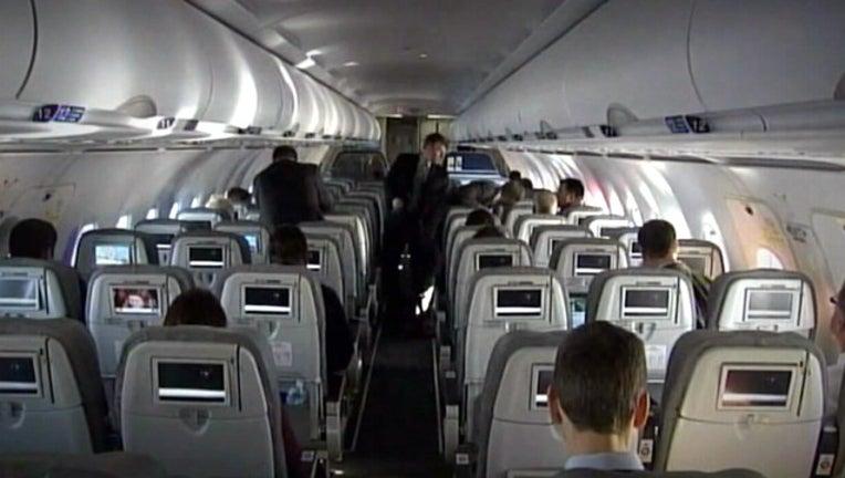 e9495548-inside airplane_1447794567516.jpg