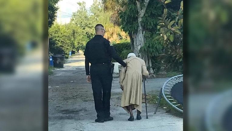 4d5d6915-sppd officer walks woman home_1567114228918.jpg.jpg