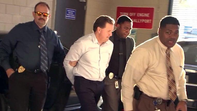2ab953fe-Lakeland commissioner arrested