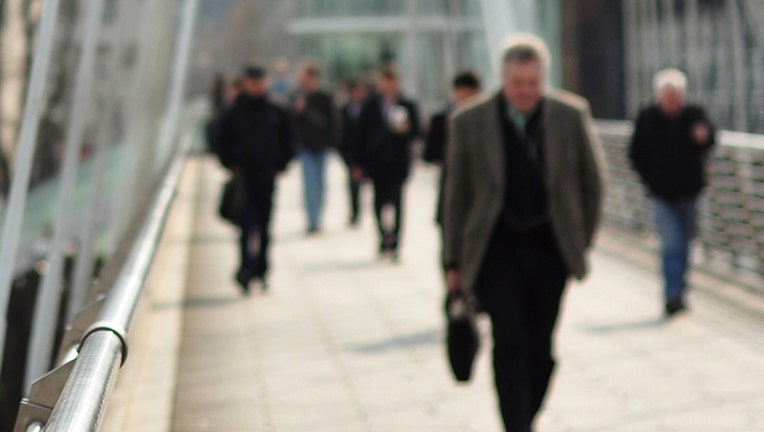 ac68ffd2-walking to work  file photo_1454329900114.jpg