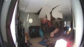 Tree crashes through roof onto girls watching TV in living room