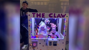 THE CLAW: 2 daughters dressed up as toys inside claw machine in parents' 'most ambitious costume to date'