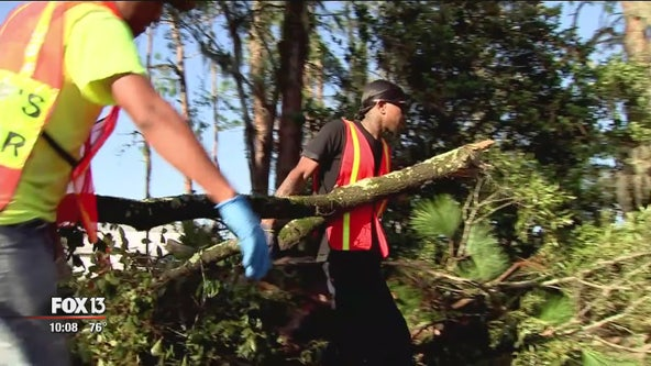 Polk County inmates help residents with tornado cleanup