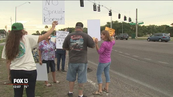 Residents picket to protest urban sprawl