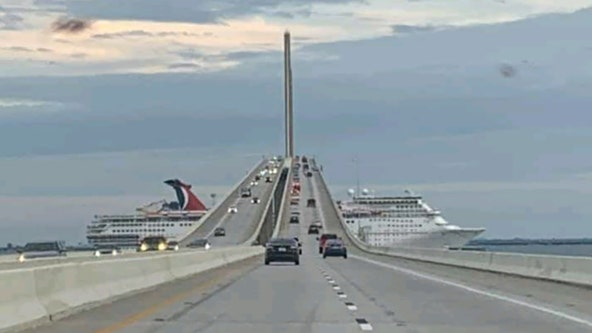 Great timing: passenger in car captures shot of cruise ship sailing under Sunshine Skyway