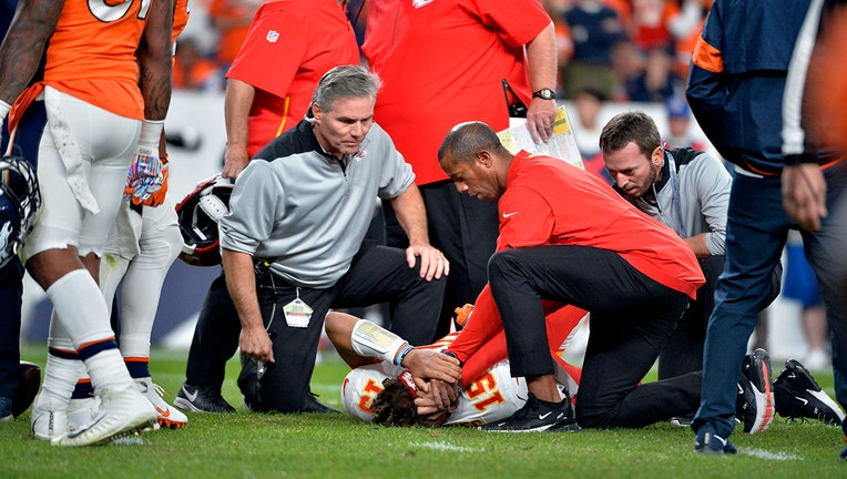 DENVER, CO - OCTOBER 17: Kansas City Chiefs quarterback Patrick Mahomes (15) gets tended to on the ground due to an injury during the second quarter of the game on Thursday, October 17, 2019 at Empower Field at Mile High. The Denver Broncos hosted the Kansas City Chiefs for the game. Photo by Eric Lutzens/MediaNews Group/The Denver Post via Getty Images