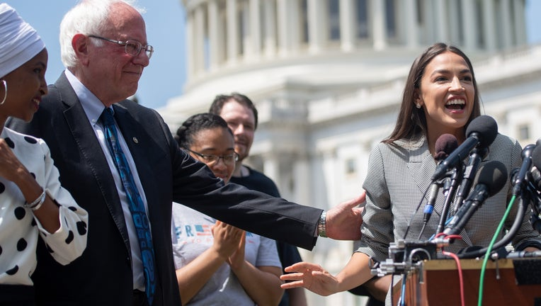 Representative Alexandria Ocasio-Cortez (2nd R), Democrat of New York, speaks alongside US Senator Bernie Sanders (2nd L), Independent of Vermont, and Representative Ilhan Omar (L), Democrat of Minnesota, during a press conference to introduce college affordability legislation outside the US Capitol in Washington, DC, June 24, 2019. (Photo by SAUL LOEB / AFP) (Photo credit should read SAUL LOEB/AFP/Getty Images)
