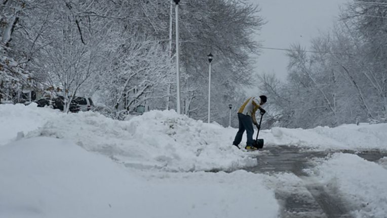 22e24b56-Shoveling-snow-photo_1570934793557.jpg