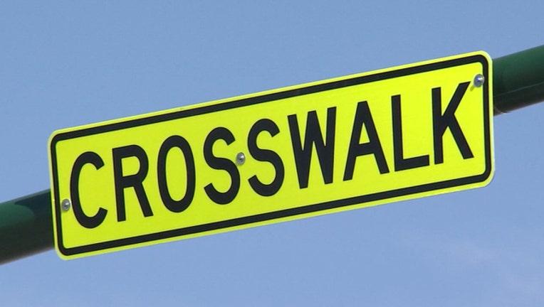 ce7d4a0a-crosswalk sign_1571050751544.jpg.jpg