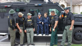 SWAT officers surprise boy hit by truck on Halloween