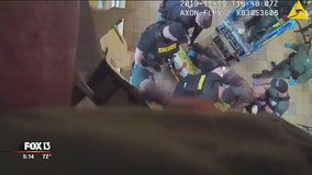 Body camera video shows suspect pulled from Walmart ceiling
