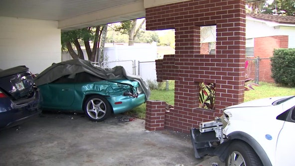 Truck plows into Lakeland carport, drives away