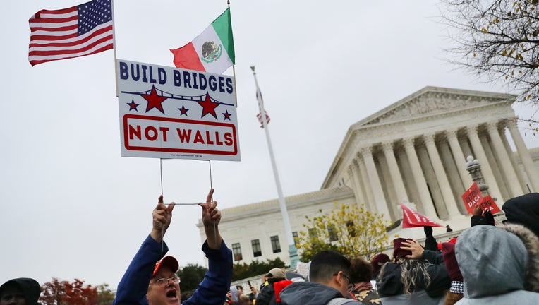 Hundreds of people gather outside the U.S. Supreme Court to rally in support of the Deferred Action on Childhood Arrivals program as the court hears arguments about DACA November 12, 2019 in Washington, DC. (Photo by Chip Somodevilla/Getty Images)