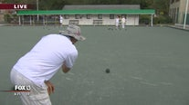 Chip gets a lesson in lawn bowling