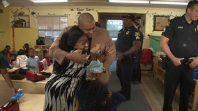 St. Pete police surprise families with $100 gift cards for the holidays