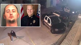 Arkansas police officer 'executed' in car was shot 10 times in the head, investigators say as video emerges