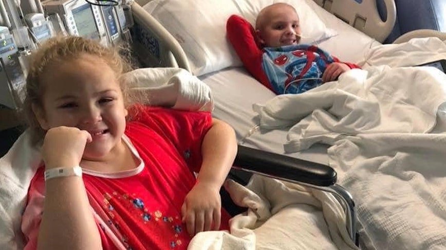 One year after sister donates bone marrow to brother, siblings give toys to hospitalized kids