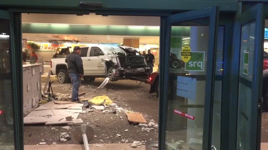 Raw Footage Shows Truck That Crashed Into Sarasota Airport
