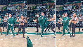 USF athletic director delights fans by joining dance squad for basketball halftime show