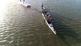 Breast cancer survivors on this dragon boat paddling team stay in sync together