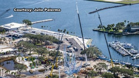 Massive hanging rope sculpture being installed at St. Pete Pier