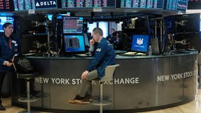 Stocks trim gains on Fed speak as oil soars
