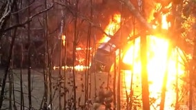 CSX workers cling to burning train derailed into Kentucky river