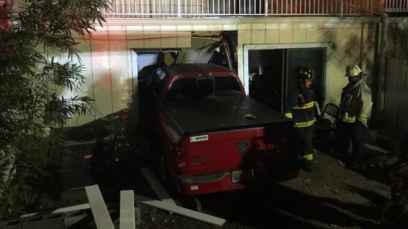 Truck crashes into home, injures 1 near Ruth Eckerd Hall