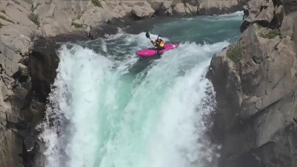 Kayaker captured on camera taking daring dive off waterfall
